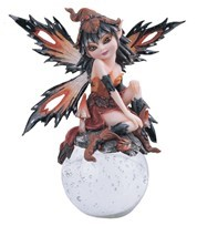 "GEORGE S. CHEN CORP 91495 AUTUMN ELF IN RED ON GLASSBALL 6"" HIGH"