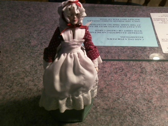"""PORCELAIN DOLL WITH BONNET AND APRON.STANDS APPX 8"""" TALL"""