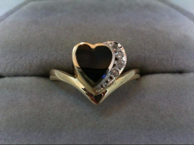 Lady's Diamond Fashion Ring 4 Diamonds .04 Carat T.W. 14K Yellow Gold 2.7g