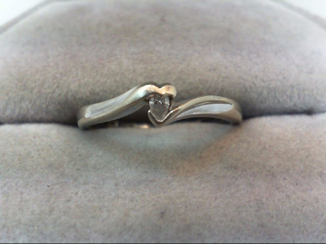 Lady's Diamond Solitaire Ring .06 CT. 10K White Gold 1.6g