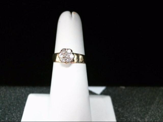 Lady's Diamond Cluster Ring 7 Diamonds .21 Carat T.W. 10K Yellow Gold 2.3g