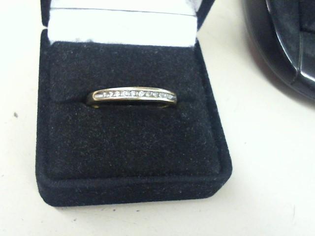 Lady's Diamond Wedding Band 11 Diamonds .11 Carat T.W. 10K Yellow Gold 2.2g