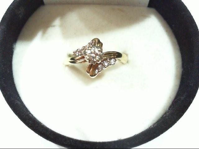 Lady's Diamond Engagement Ring 7 Diamonds .16 Carat T.W. 14K Yellow Gold 3.1g