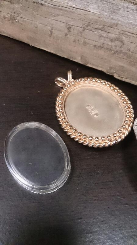 Gold-Diamond Solitaire Pendant .06 CT. 10K Yellow Gold 11.7g