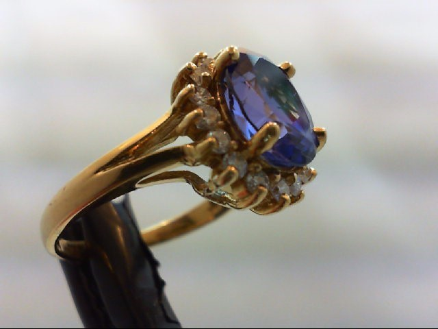 Tanzanite Lady's Stone & Diamond Ring 16 Diamonds 0.48 Carat T.W. 18K Yellow Gol