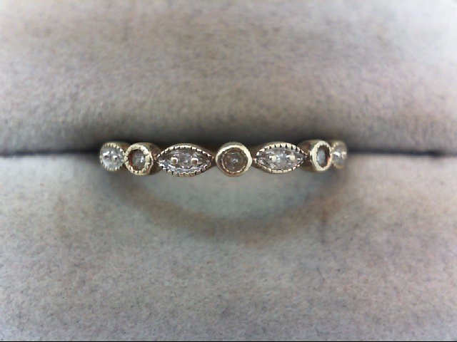 Lady's Diamond Wedding Band 7 Diamonds .07 Carat T.W. 10K Yellow Gold 1.3g