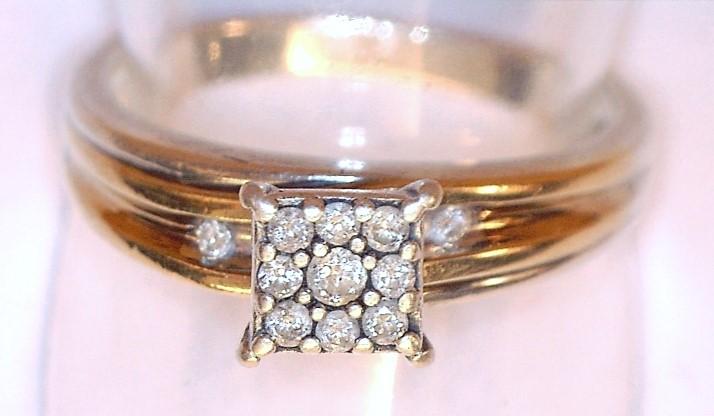 Lady's Silver-Diamond Ring 11 Diamonds .11 Carat T.W. 925 Silver 2.34dwt Size:7
