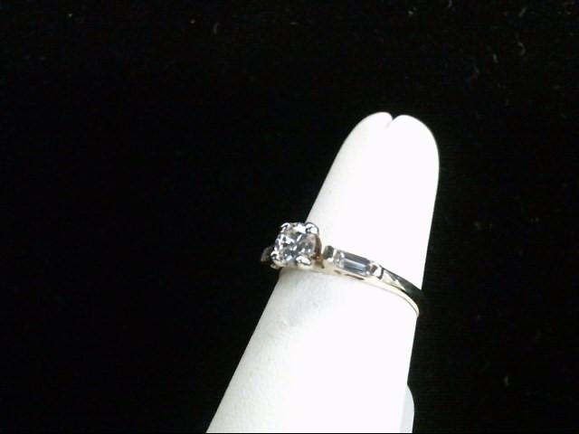 Lady's Diamond Engagement Ring 3 Diamonds .52 Carat T.W. 14K Yellow Gold 2.7g