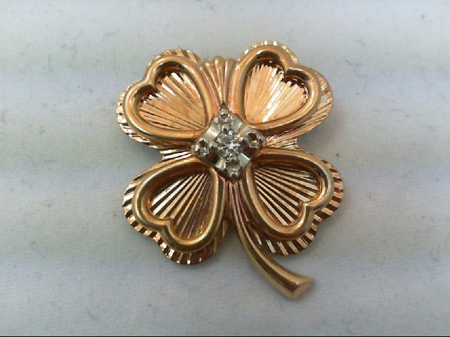 Gold-Diamond Brooch .11 CT. 10K Yellow Gold 6.6g