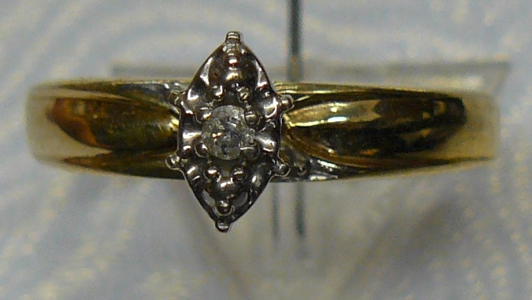 Lady's Diamond Solitaire Ring .03 CT. 10K Yellow Gold 1.6dwt Size:7