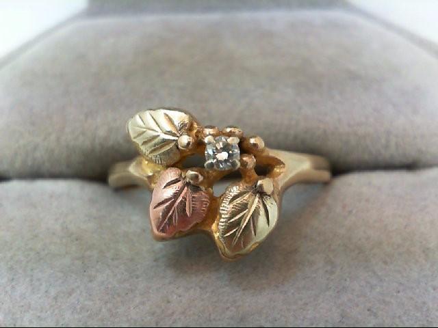 Lady's Diamond Fashion Ring .07 CT. 10K Tri-color Gold 2.7g