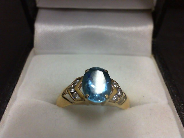 Blue Topaz Lady's Stone & Diamond Ring 6 Diamonds 0.18 Carat T.W. 14K Yellow Gol