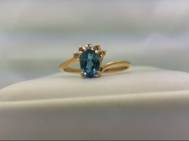 Blue Topaz Lady's Stone & Diamond Ring 5 Diamonds 0.05 Carat T.W. 14K Yellow Gol