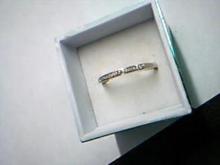 Lady's Diamond Wedding Band 15 Diamonds .15 Carat T.W. 10K Yellow Gold 1.64g