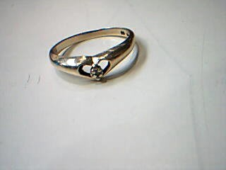 Lady's Diamond Solitaire Ring .02 CT. 10K Yellow Gold 1.7g