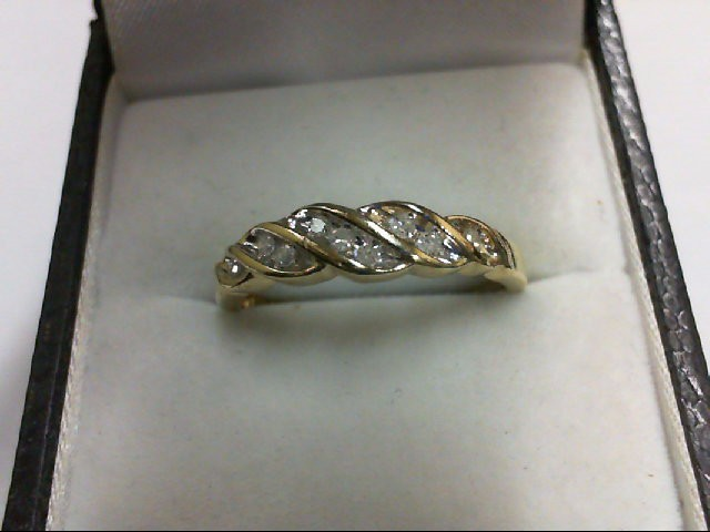 Lady's Diamond Cluster Ring 9 Diamonds 0.09 Carat T.W. 10K Yellow Gold 2.5g