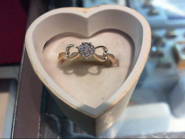 Lady's Diamond Cluster Ring 7 Diamonds .09 Carat T.W. 10K Yellow Gold 2.1g