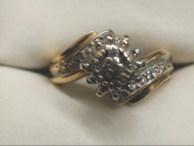 Lady's Diamond Cluster Ring .01 CT. 10K Yellow Gold 3.5g Size:7.5