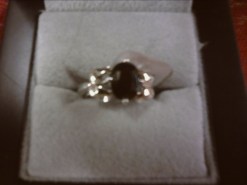 BLACK FACETED OVAL STONE WITH TWO CLEAR STONE SIZE 5.5