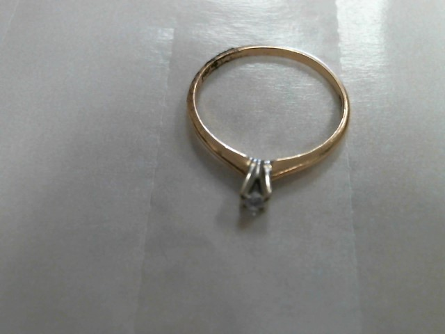 Lady's Diamond Solitaire Ring .04 CT. 14K Yellow Gold 0.9dwt