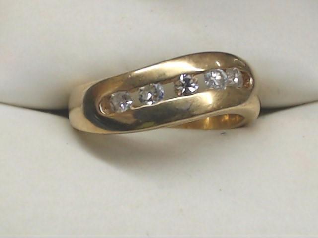 Lady's Diamond Fashion Ring 5 Diamonds .20 Carat T.W. 10K Yellow Gold 4.2g