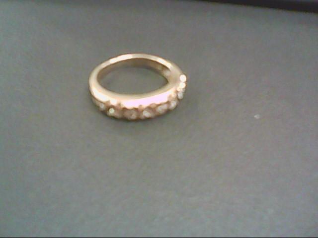 Lady's Diamond Fashion Ring 8 Diamonds .08 Carat T.W. 10K Yellow Gold 2.5g