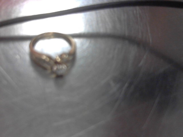Lady's Diamond Solitaire Ring 11 Diamonds .14 Carat T.W. 10K Yellow Gold 4.3g