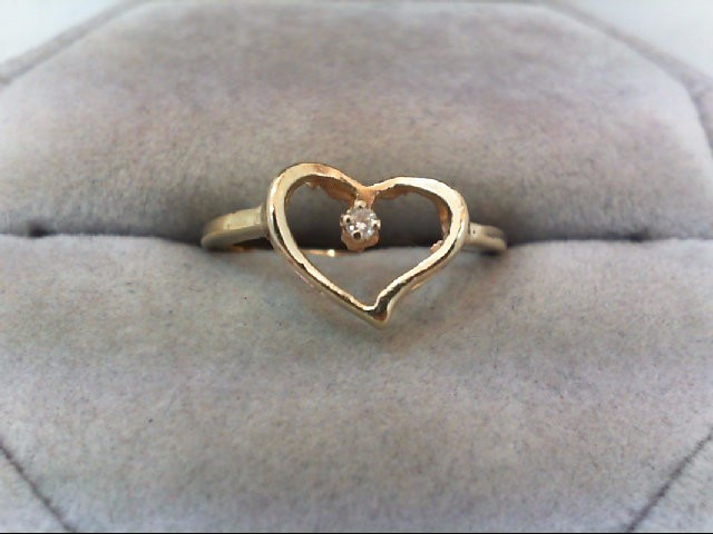 Lady's Diamond Fashion Ring .02 CT. 14K Yellow Gold 2.2g