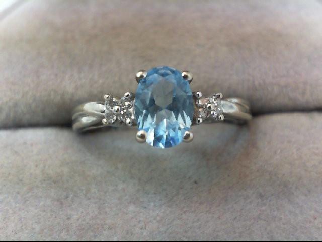 Blue Topaz Lady's Stone & Diamond Ring 8 Diamonds .08 Carat T.W. 10K White Gold