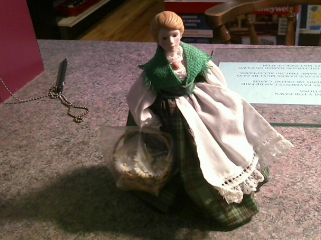 PORCELAIN DOLL.SCOTTISH LASS WITH BASKET OF FLOWERS.TARTAN AND SHAWL.STANDS APPX
