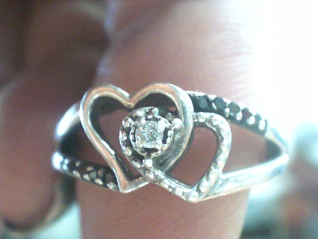 Lady's Silver-Diamond Ring 11 Diamonds .12 Carat T.W. 925 Silver 2.1dwt