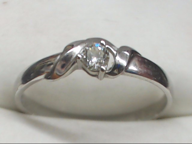 Lady's Diamond Solitaire Ring .12 CT. 18K White Gold 1.5g Size:7