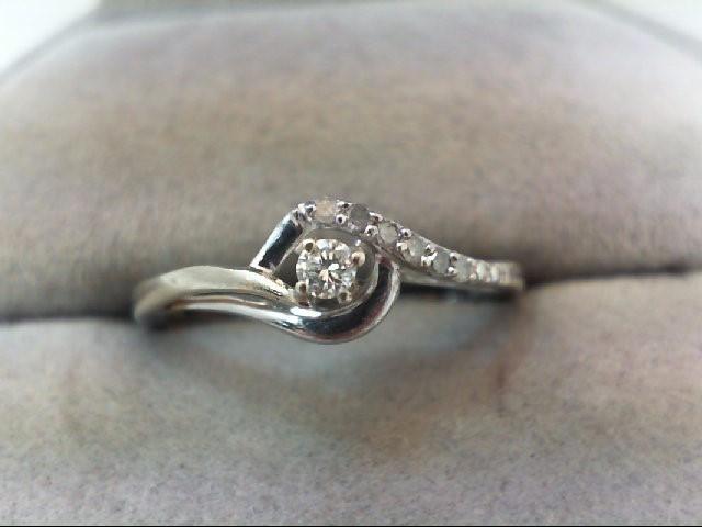 Lady's Silver-Diamond Ring 7 Diamonds .12 Carat T.W. 925 Silver 2g