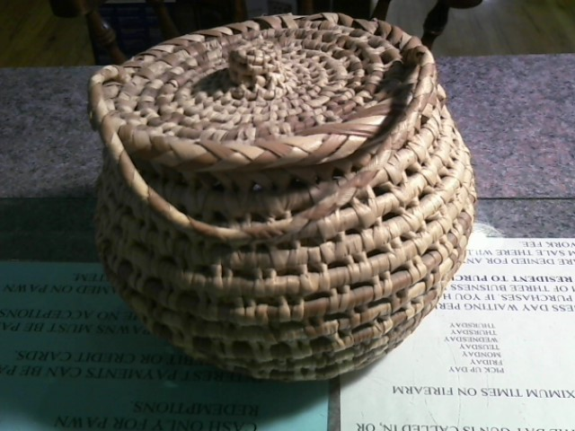 NATIVE ART BASKETS AND STONE POLAR BEAR CARVING