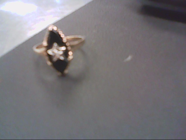 Black Stone Lady's Stone & Diamond Ring .005 CT. 10K Yellow Gold 1.7g Size:5.8