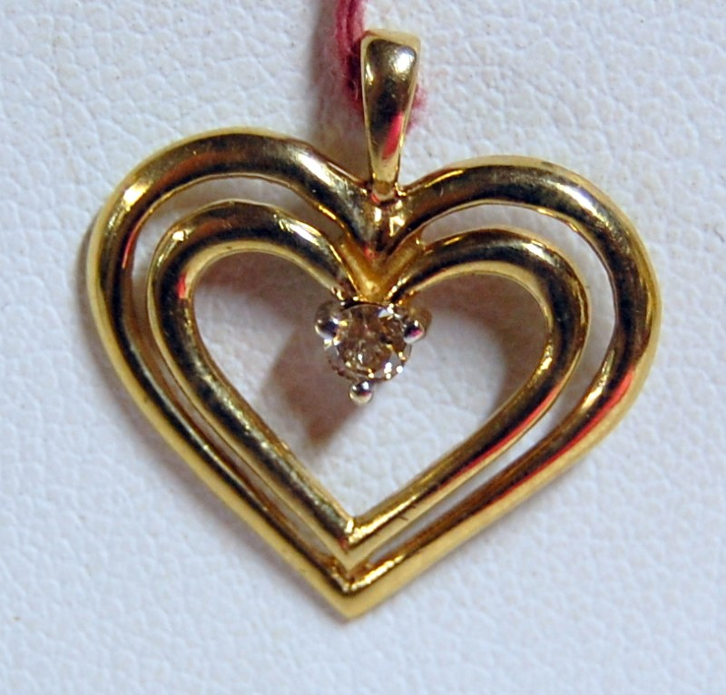 Gold-Diamond Solitaire Pendant .05 CT. 10K Yellow Gold 1.2g