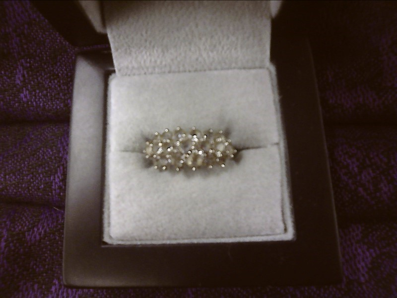 STERLING SILVER RING W/ CLEAR STONES SIZE: 6 1/2