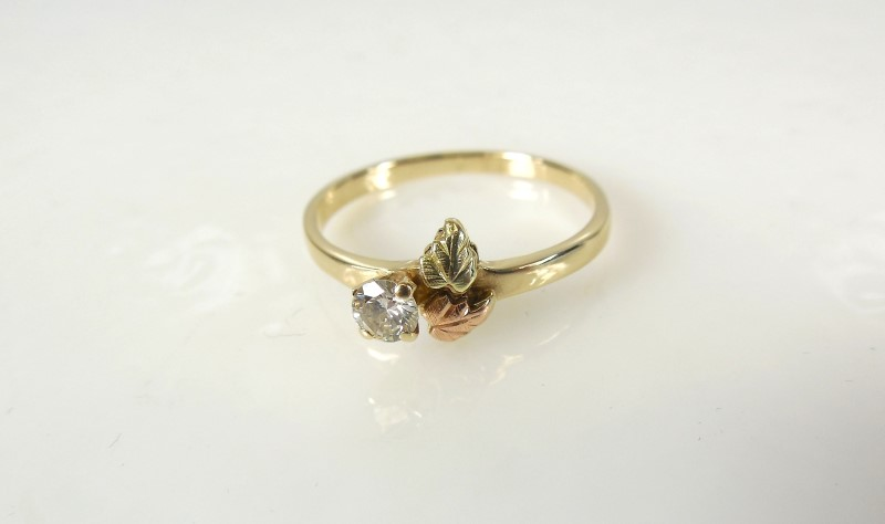 Lady's Diamond Solitaire Ring .10 CT. 10K Tri-color Gold 1.4g Size:6.5