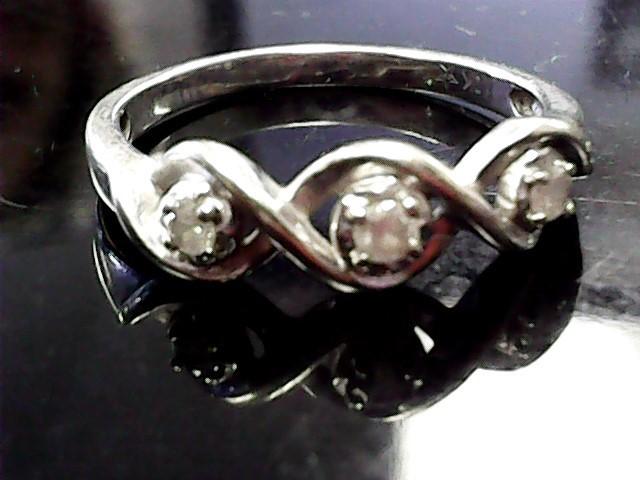 Lady's Diamond Fashion Ring 3 Diamonds .06 Carat T.W. 10K White Gold 1.3dwt