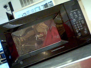 GE Microwave/Convection Oven 610TATG311929