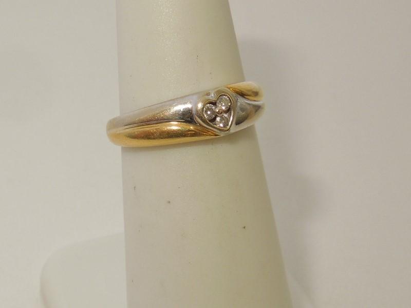 Lady's Diamond Fashion Ring 3 Diamonds .03 Carat T.W. 18K 2 Tone Gold 2.9g