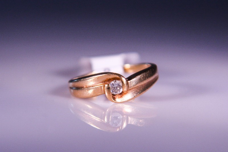 Lady's Diamond Solitaire Ring .05 CT. 10K Yellow Gold 2.2g
