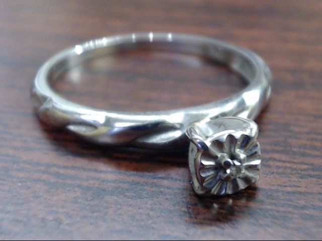 Lady's Diamond Engagement Ring .01 CT. 10K White Gold 1.5g Size:6.5