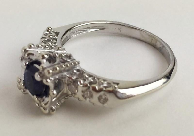 Lady's Sapphire & Diamond Ring .12 Carat T.W. 14K WG Size 5.5