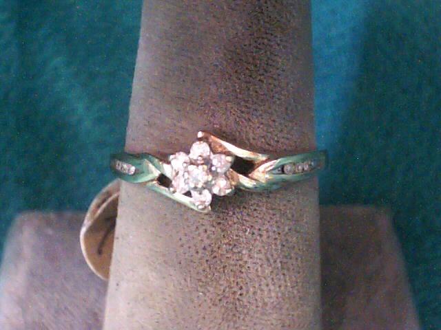 Lady's Diamond Fashion Ring 7 Diamonds .040 Carat T.W. 10K Yellow Gold 1.2dwt