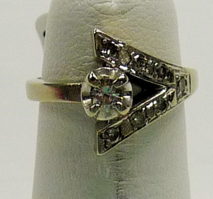 Lady's Diamond Fashion Ring .05 CT. 14K White Gold 2.16dwt