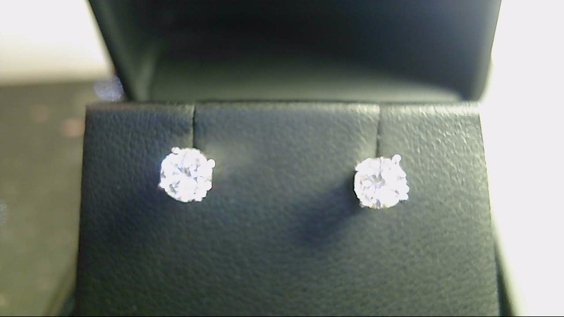 lady's 14k white gold apx. (.66ctw) round diamond stud earrings