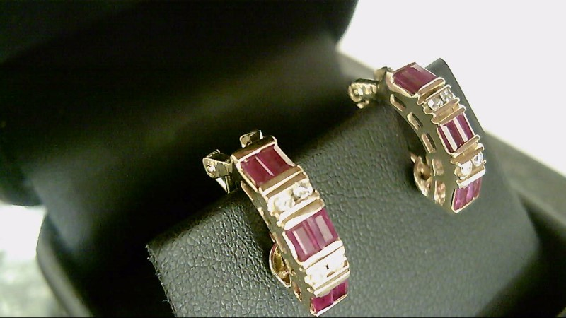 Lady's 14k yellow gold genuine baguette ruby and round diamond earrings