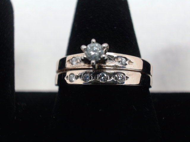 Lady's Diamond Solitaire Ring .05 CT. 14K Yellow Gold 4.1g
