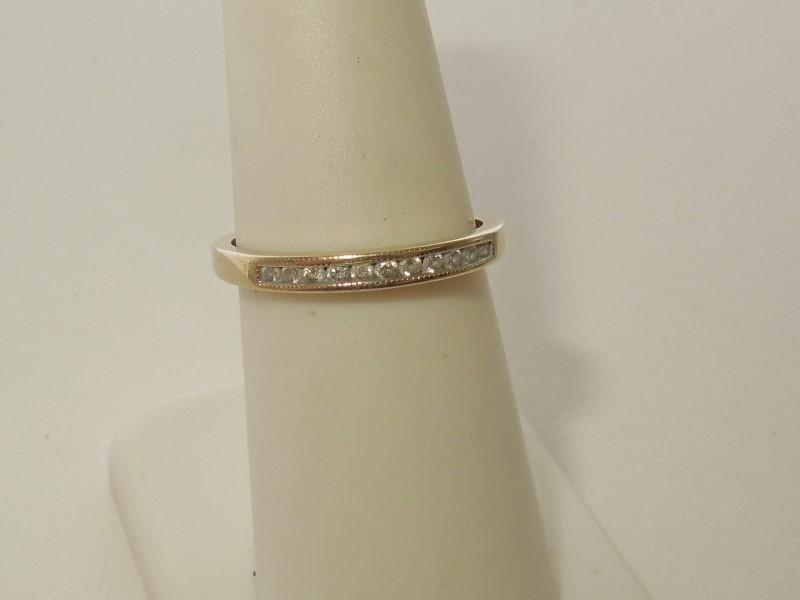 Lady's Diamond Wedding Band 11 Diamonds .11 Carat T.W. 14K Yellow Gold 1.5g